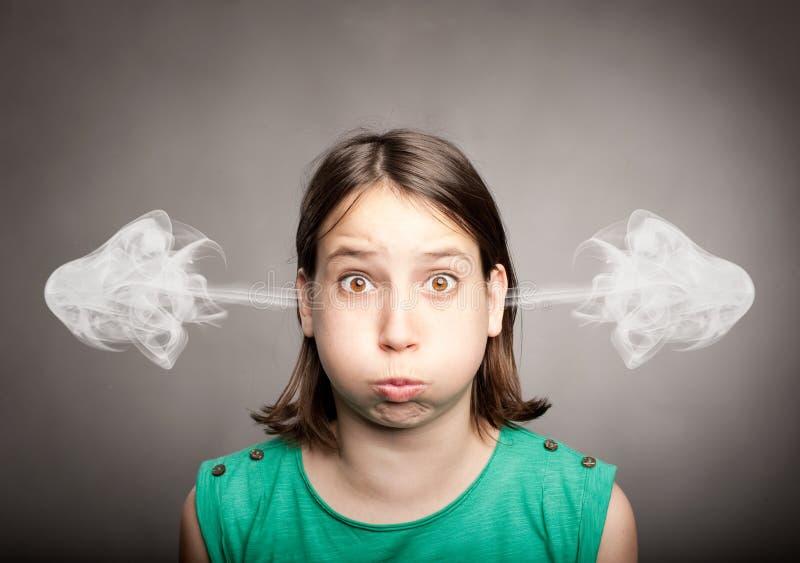 Dziewczyna z dymem na jej ucho zdjęcia stock