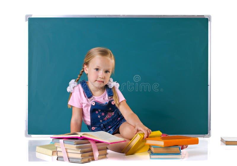 Dziewczyna z książkami zdjęcia royalty free