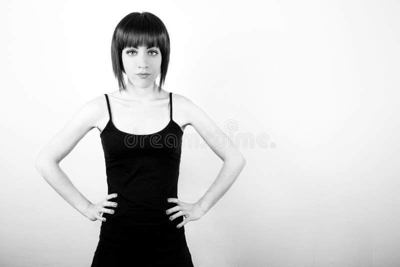 Dziewczyna z rękami na biodrach fotografia stock