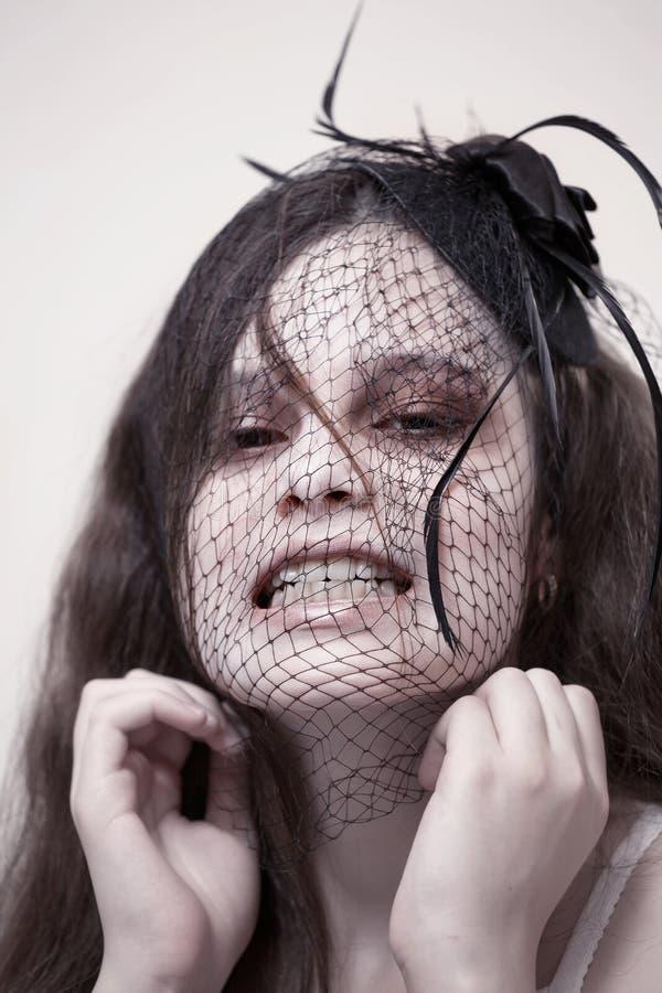 Dziewczyna z straszną twarzą obraz stock