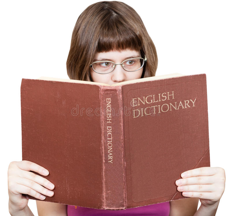 Dziewczyna z szkłami czyta Angielską słownik książkę fotografia stock