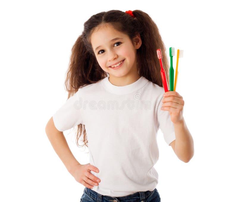 Dziewczyna z toothbrushes zdjęcia stock