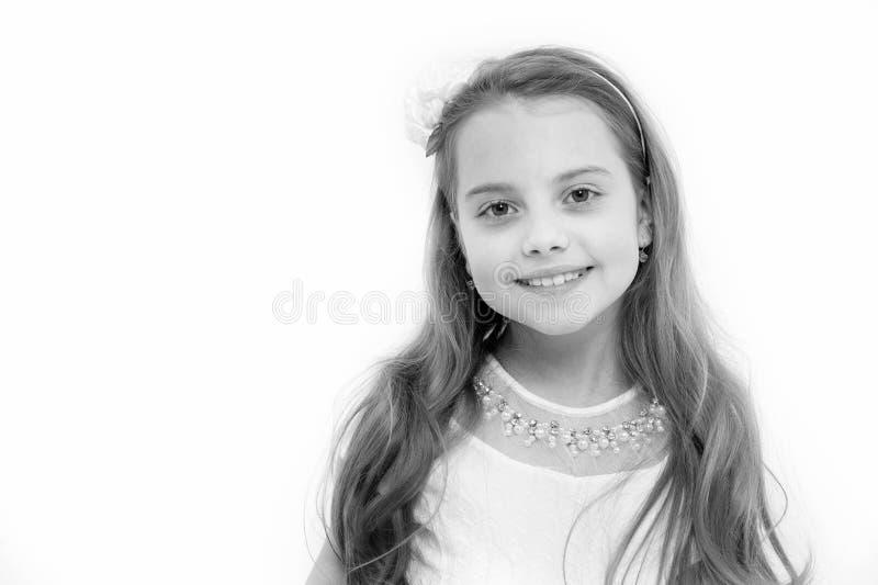 Dziewczyna z uśmiechem na ślicznej twarzy odizolowywającej na bielu obraz stock