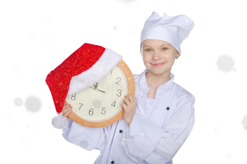 Dziewczyna z zegarem, Santa kapeluszem i śniegiem, fotografia royalty free