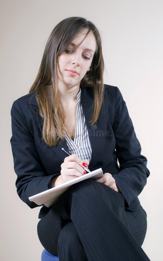 dziewczyna zauważa sekretarki ładnego writing zdjęcia stock