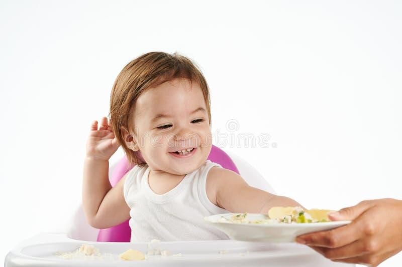 Dziewczynki sztuka z jedzeniem obrazy stock