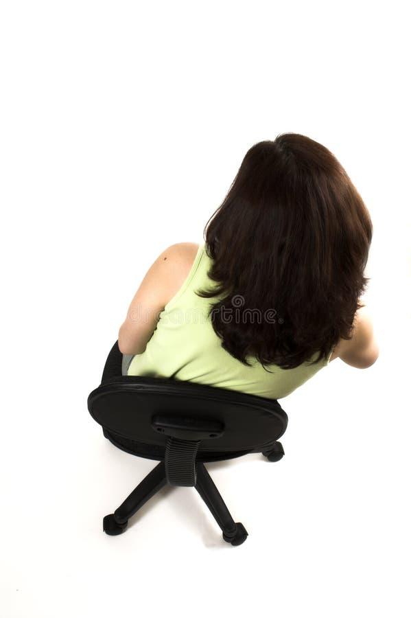 dziewczyny źle postury posiedzenia zdjęcie royalty free
