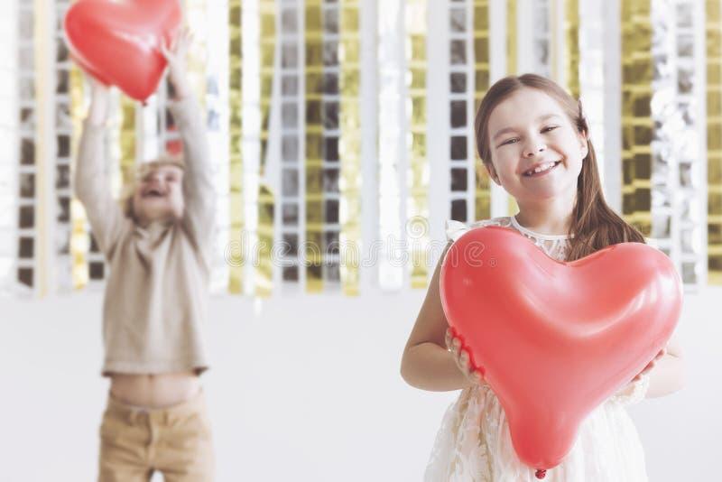 dziewczyny czerwień szczęśliwa kierowa obraz royalty free