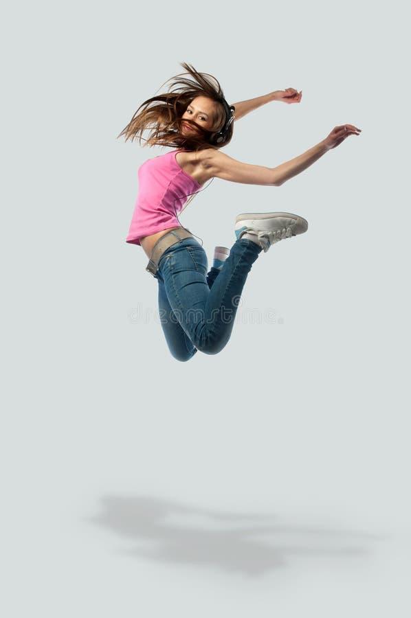 dziewczyny hełmofonów skoki obraz royalty free