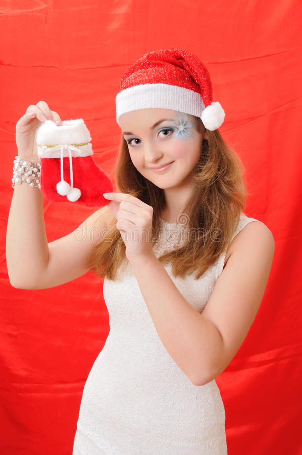 dziewczyny kapeluszowego chwyta ładna czerwona Santa skarpeta zdjęcia stock