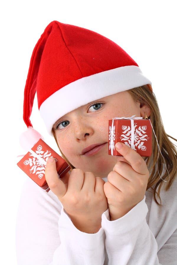 dziewczyny kapeluszowego mienia odosobnione małe teraźniejszość Santa obraz stock