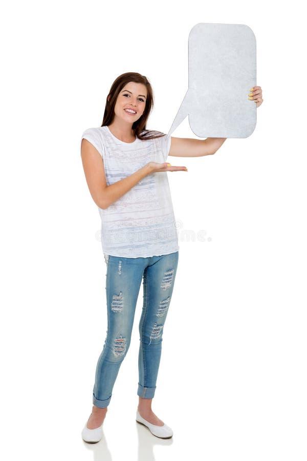 Dziewczyny mienia mowy bąbel fotografia stock