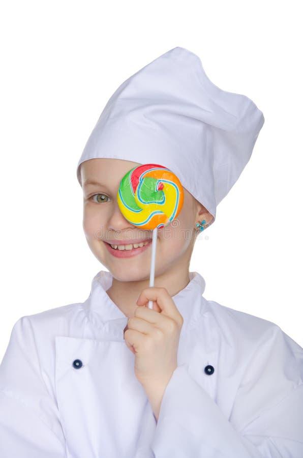Dziewczyny oka kucharz zakrywający cukierek obrazy stock