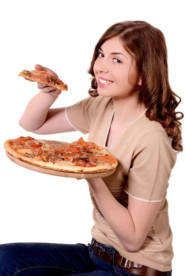 Dziewczyny próba i kąsek pizza zdjęcia royalty free