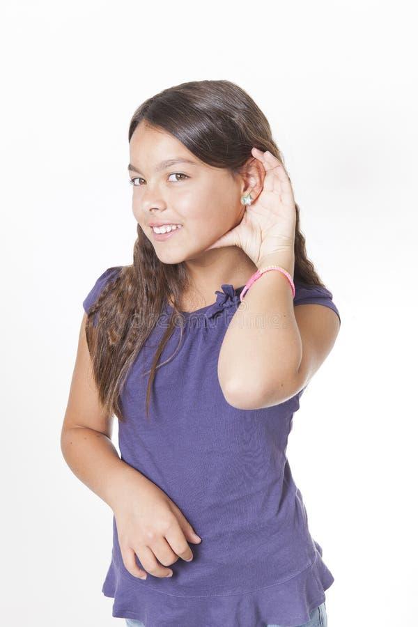 Dziewczyny słuchanie z ręką ucho zdjęcia stock