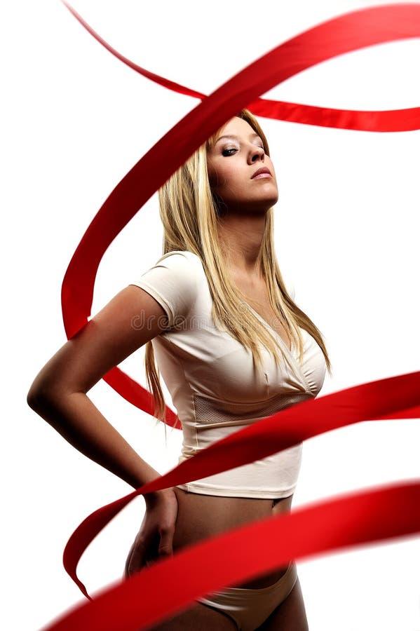 dziewczyny seksowny czerwony tasiemkowy atłasowy fotografia stock