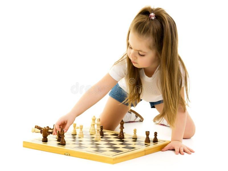 dziewczyny szachowej ma?a gra Bia?y t?o zdjęcia royalty free