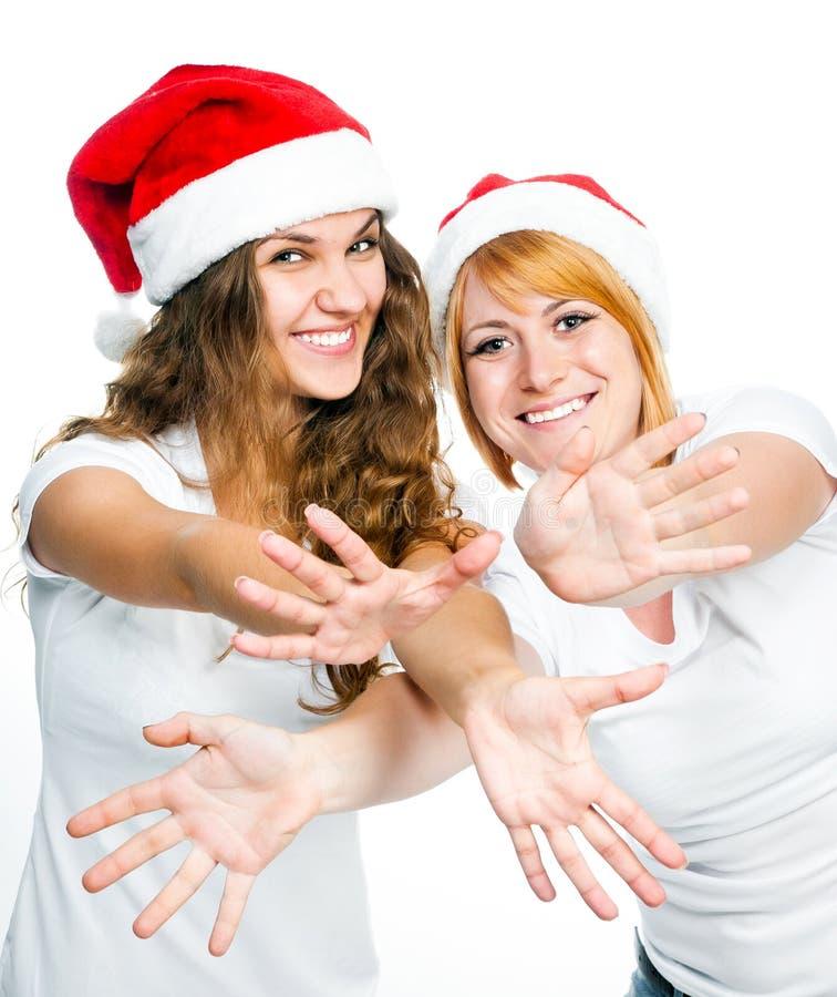 Dziewczyny w Santa kapeluszu zdjęcia stock