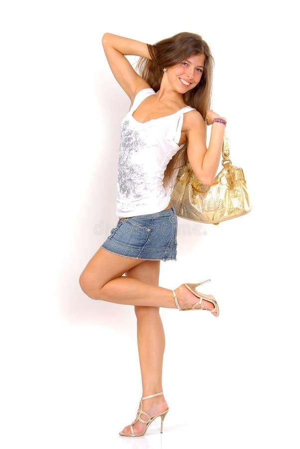 dziewczyny złota torebka zdjęcia stock