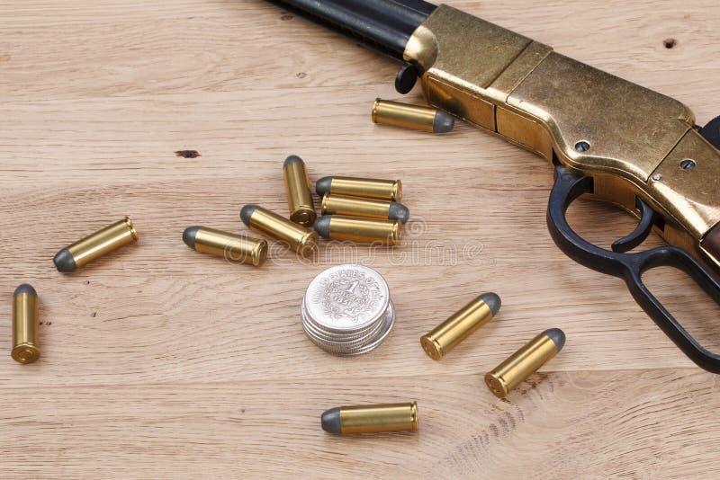 Dziki zachodu pistolet z cyklami fotografia royalty free