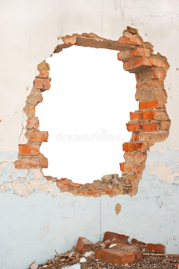 Dziury ściana z cegieł obrazy stock