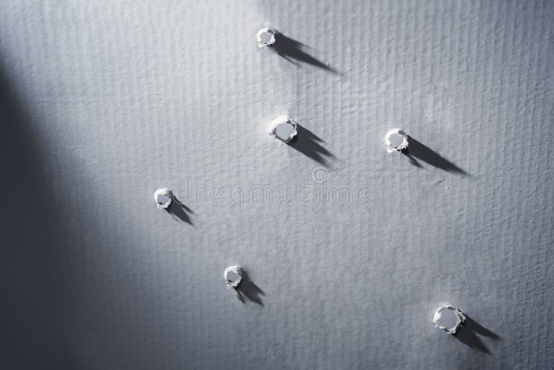 Dziury w papierze Strzał imitacja zdjęcie royalty free