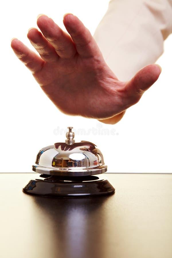 dzwonkowy ręki ciupnięcia hotel zdjęcia stock