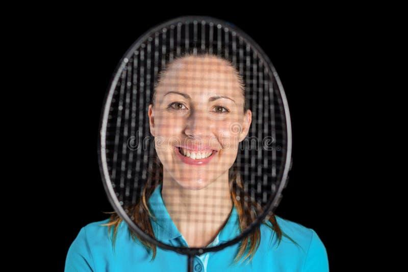 Żeńska atleta pozuje z badminton kantem obraz royalty free