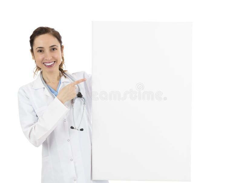 Żeńska pielęgniarka lub lekarka wskazuje reklamy deska zdjęcia stock