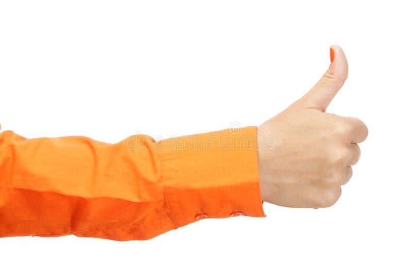 Żeńska ręka w pomarańczowej koszula obraz stock