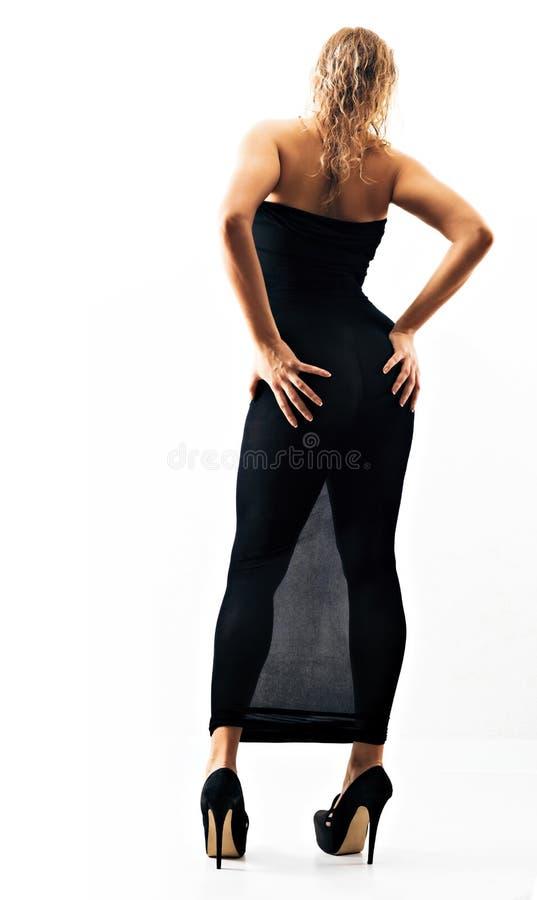 Żeńska sylwetka w czarnej nylonowej ciało pończosze w szpilki butach i obraz stock