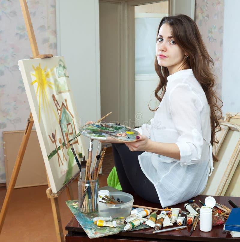 Żeński artysta farb obrazek na kanwie obrazy stock