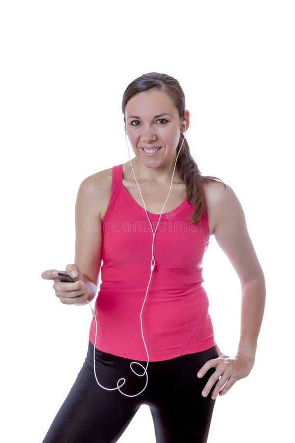 Żeński biegacz i słuchawki obraz stock