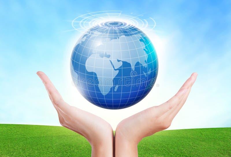 Żeńskie ręki save środowiska utrzymanie w światowej błękitnej planecie zdjęcia stock