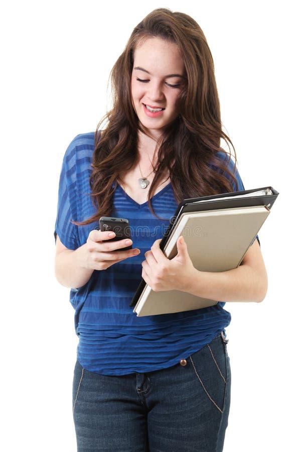 Żeńskiego ucznia texting zdjęcie royalty free