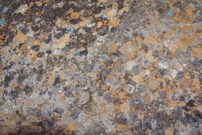 E Κλείστε επάνω του υποβάθρου σύστασης πετρών Ζωηρόχρωμο φυσικό υπόβαθρο πετρών interesting στοκ εικόνα με δικαίωμα ελεύθερης χρήσης