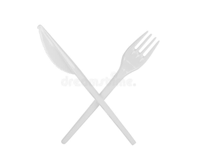 E 在白色背景隔绝的现实白色塑料碗筷 库存图片