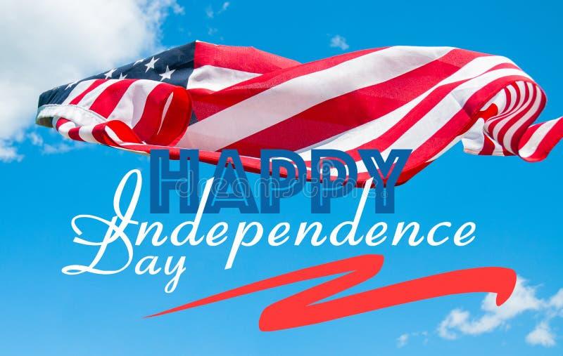 E 美国国旗在天空蔚蓝背景中 免版税库存照片