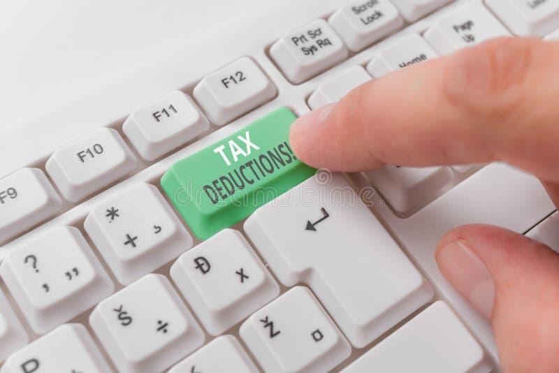 E 能被收税费用白色个人计算机的减少收入的企业概念 库存图片