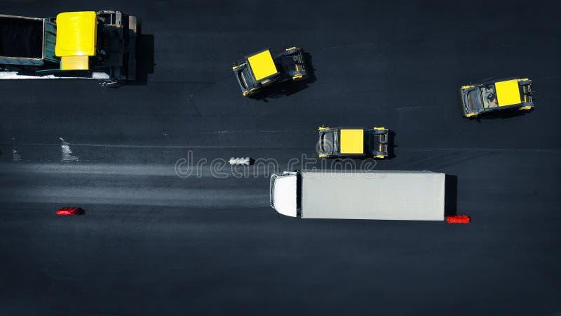 E 路修理背景 压路机机器滚动沥青 r 库存照片