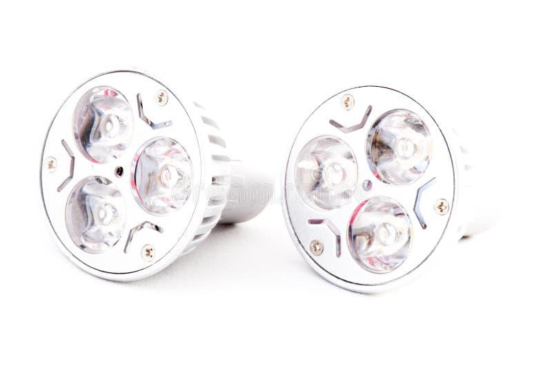 Deux ampoules économiseuses d'énergie de LED avec la lumière chaude images libres de droits