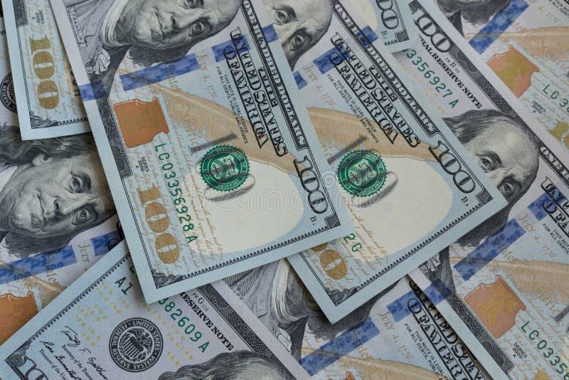 E Amerikanische Dollar Geld- Hundert Dollarschein- Beschaffenheit von hundert US-Dollars Banknoten lizenzfreie stockfotografie