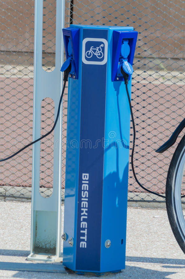E-bike charging station. The Hague, Scheveningen Pier, Netherlands - August 7, 2014: Here in the photo the beach promenade of Scheveningen. There are charging stock image