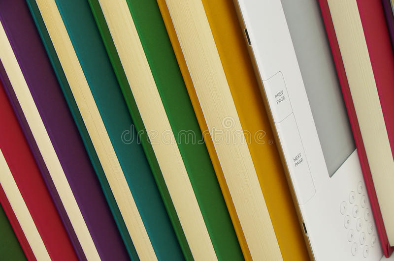 E book and coloured reading books stock images