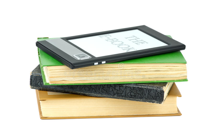 E-book reader and classic paper books. Isolated on the white background stock photography