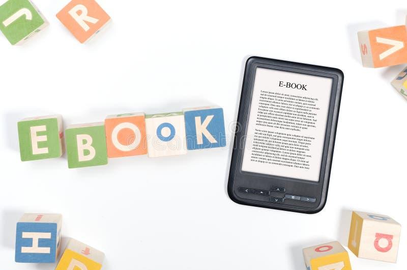 E-book reader device and toy blocks concept. E-book reader device and toy blocks top view concept stock photos