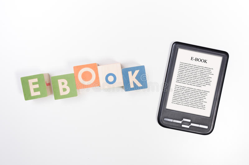 E-book reader device and toy blocks concept. E-book reader device and toy blocks top view concept royalty free stock photo