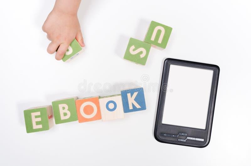 E-book reader device and toy blocks concept. E-book reader device and toy blocks top view concept royalty free stock photos
