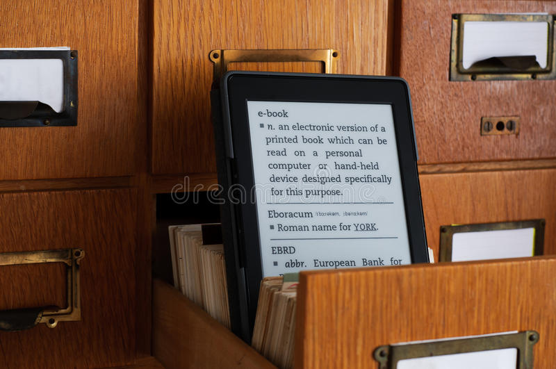 E-book Reader in Library Catalog Card Drawer - New Technology Con royalty free stock photos