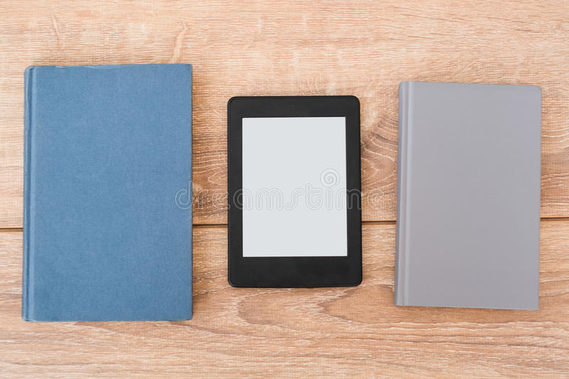E-book reader on a stack of books stock photo
